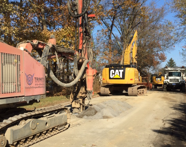 drilling and blasting equipment heading to construction site